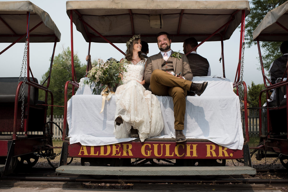 Virginia City Montana wedding day bride and groom train ride