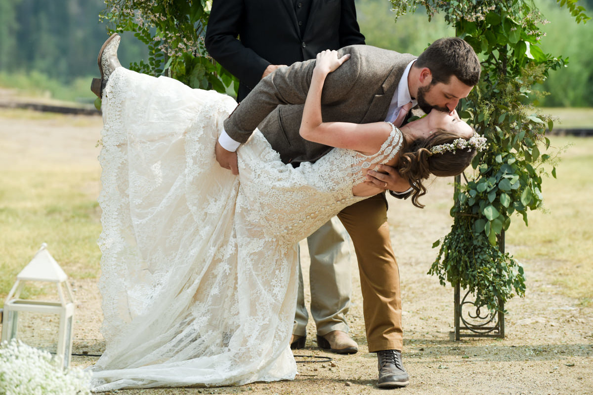 Virginia City Montana wedding day ceremony kiss