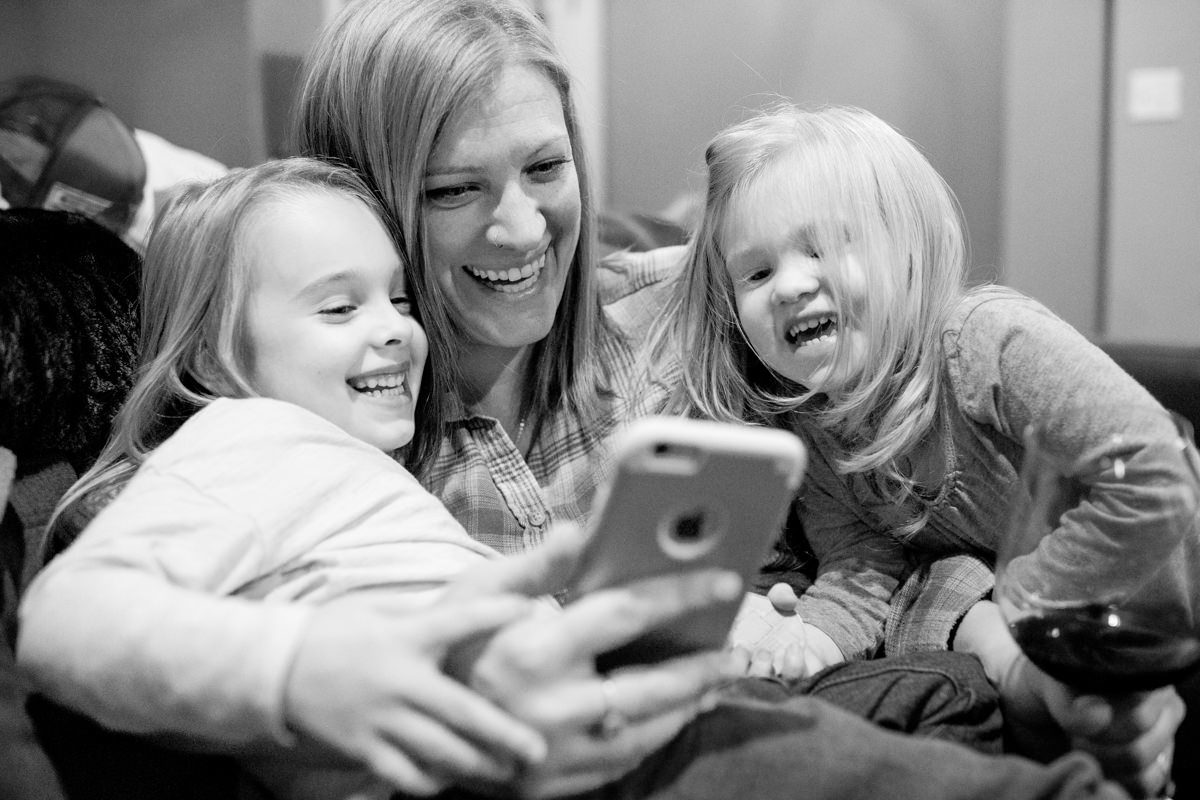 Mom with daughters smile iphone portrait