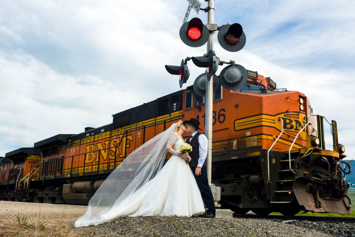 Livingston Wedding Photographer train crossing couple kiss