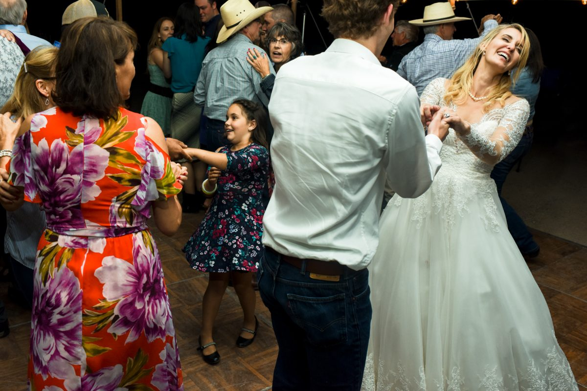 Livingston Wedding Photographer cowboy wedding dancing