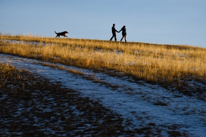 Bozeman Pet Photography Couple Sunset at Story Mill