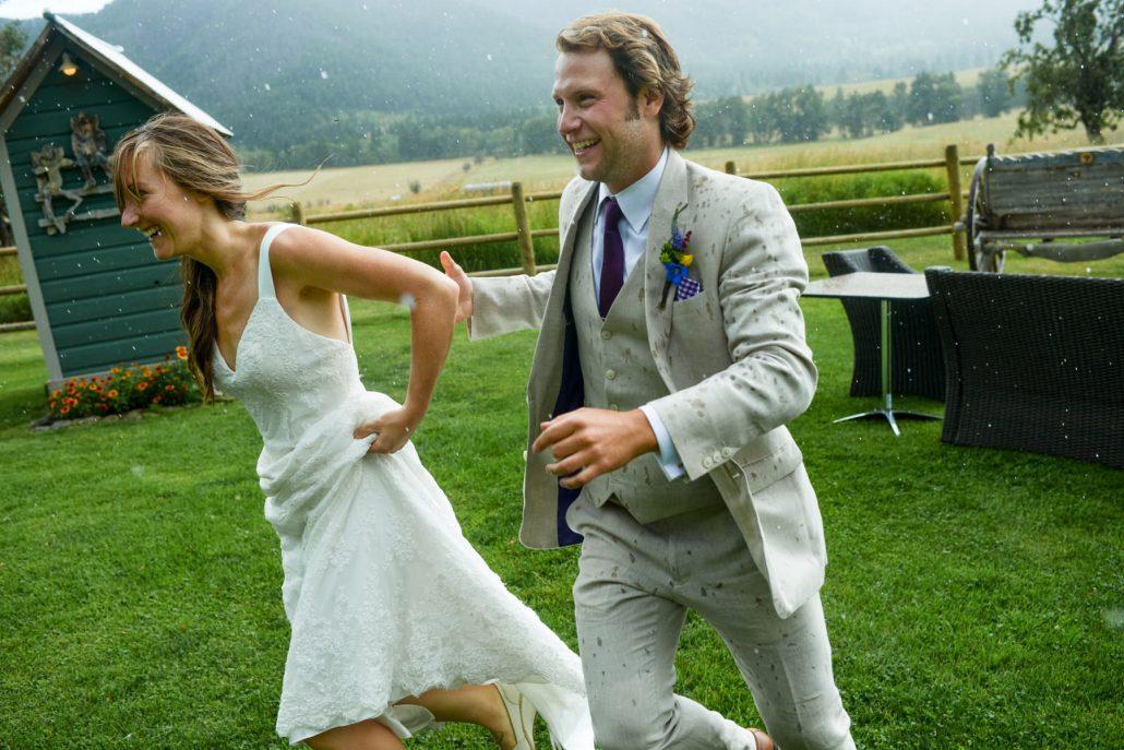 Montana Wedding Photographer Springhill Pavilion bride and groom in rain