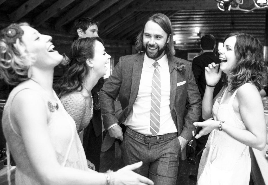 Montana Wedding Photographer Springhill Pavilion guests laugh