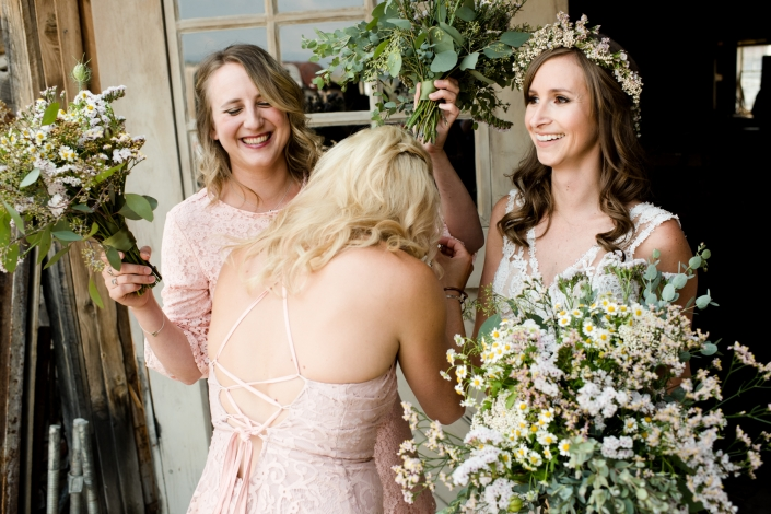 Montana Wedding Photographer Virginia City wedding flowers laugh