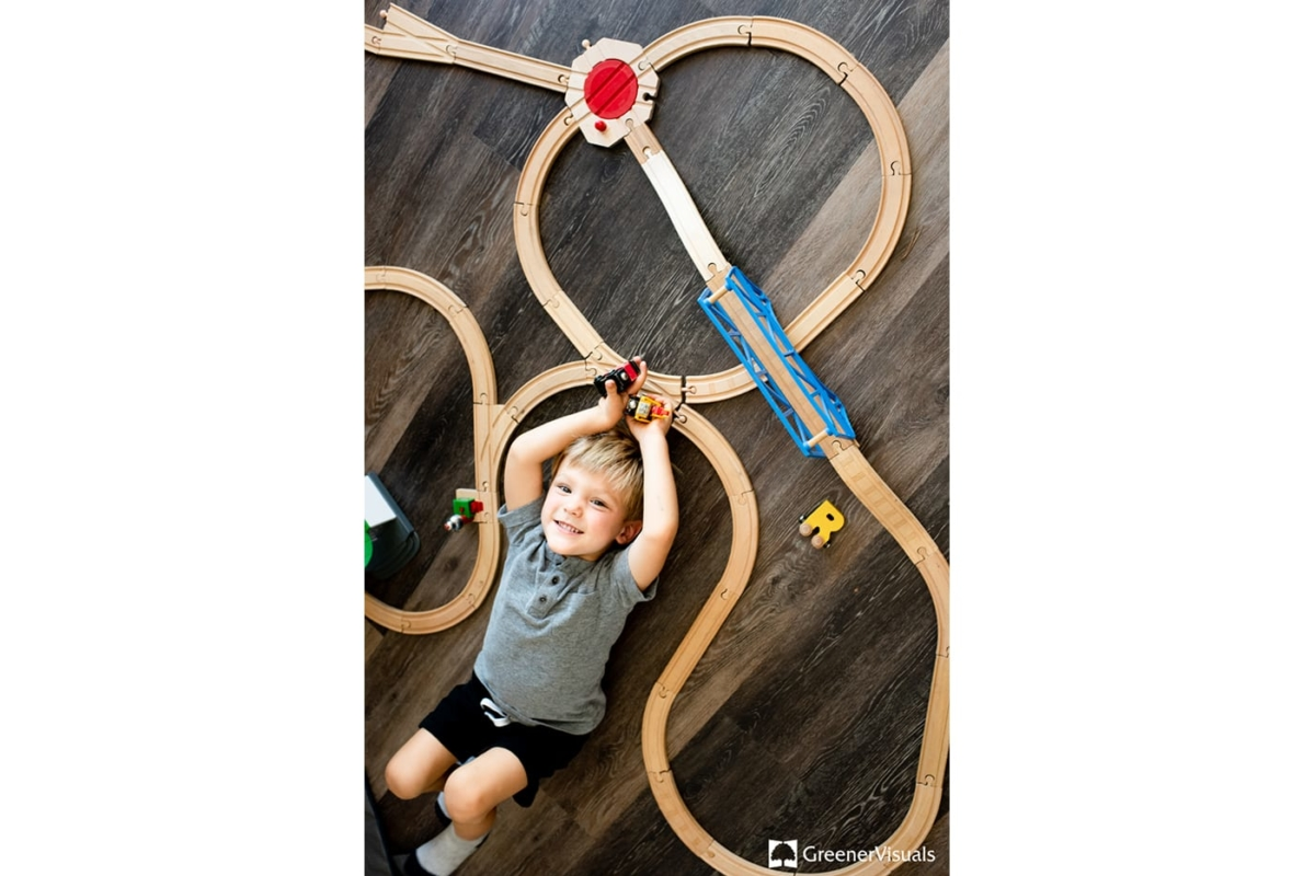 Boy-playing-toy-trains-Family-Portrait-Photography