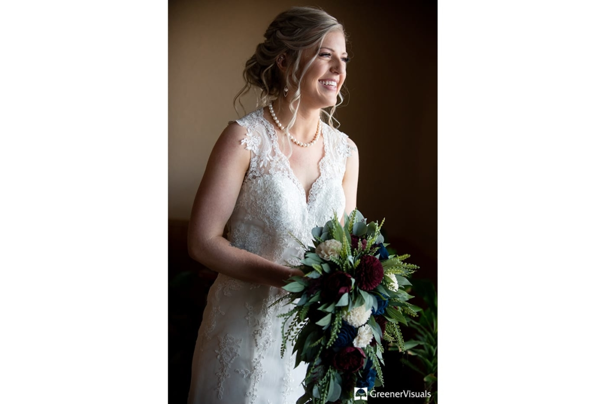 Bride with bouquet Gallatin River Lodge Winter Wedding