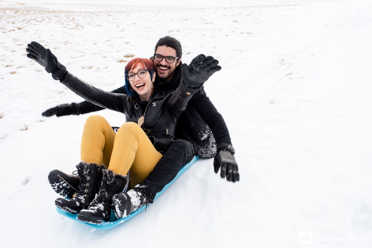 Sledding Winter Engagement Portrait Photography